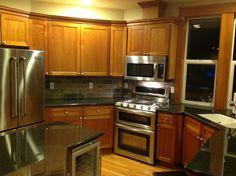black granite counters slate subway tile backsplash and cherry : kitchen renovation ideas renovations