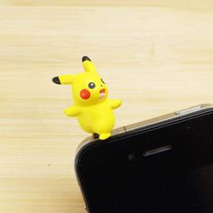 Cute 3D Happy Pikachu Pokemon Dust Plug 3.5mm Smart Phone Dust Stopper Earphone Cap Dustproof Plug Charms for iPhone 4 4S 5 HTC Samsung. $3.99, via Etsy.