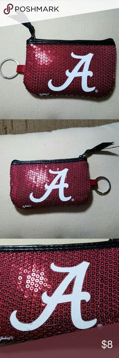"Alabama Crimson Tide Sequin Coin Purse Alabama Crimson Tide Sequin Coin Purse This sequin coin purse is very sturdy.  It has a keyring attached as well as a ribbon for the zipper pull.    I have had the same one for 3 years & its barely worn.  It measures 5"" x 3.5"".  The sequins are very close knit so they will not come offin everyday wear.  Feel free to ask any questions before purchasing.  Thanks for shopping my closet! Bags Wallets"