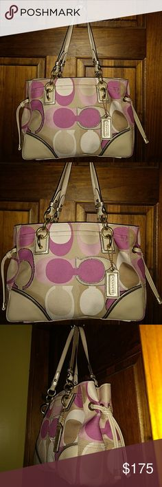 "Coach Colette Scarf Print Canvas Medium Tote 16455 Coach Colette Scarf Print Canvas Medium Tote Bag Pink Multi-color  J1020-16455 Multi-Color Pink/Beige/Metallic  Coach Signature coated canvas 2 exterior pockets front and back Four metallic brass feet Gold-tone Hardware Two compartments Center zipper pocket 2 Slip Pockets & Zipper Pocket with Coach creed Beige Lining Coach Leather Hangtag  Approx Measurements 13"" Length 8"" Height 5"" Wide 9"" Strap Drop  Pre-owned Coach Bags Shoulder Bags"
