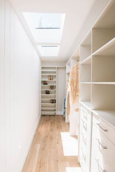 Walk-in wardrobe with skylight, light bright and white