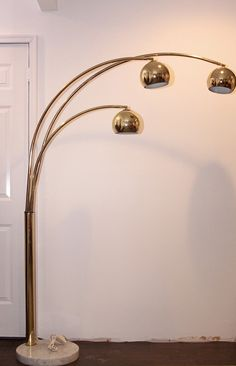 SOLD:Iconic Marble Base Brass Arc Floor Lamp By Goffredo Reggiani .