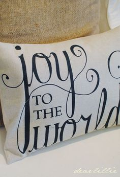 Christmas Pillow.  Print straight on the fabric or just use a sharpie...I bet you could paint them or of course embroider them as well...