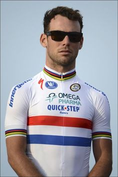 World champ's bands, national jersey, cool shades. Just an average day in the life of Mark Cavendish Esq