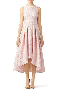 Shoshanna's pink dress features a modern high-low hemline. Try it with golden sandals.