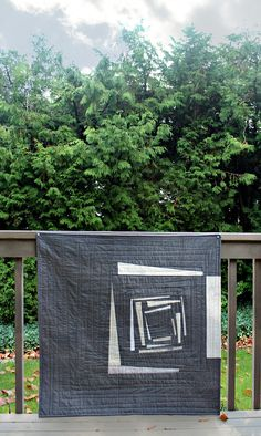 """Debbie Jeske from A Quilter's Table originally created a whimsical Log Cabin Improv as an online quilting bee block. So happy it stayed with her so she would go on to make this beauty! """"Using a rich Aurifil 50wt #5004 (Grey Smoke), I quilted in a squared spiral, reminiscent of the piecing rhythm of the most traditional log cabin block."""" To read more please visit http://aquilterstable.blogspot.com/2015/11/steeped-in-tradition.html"""