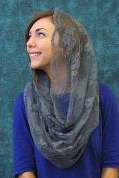An infinity scarf with a twist! This soft sheer mantilla is an infinity scarf with scalloped edges so it can be worn as part of your outfit outside the church and slipped over the head before entering. Available in black, white, ivory, brown and blue.