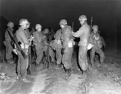 Men of the 3rd Ranger Company, 3rd Infantry Division, adjust their gear before undertaking a dawn patrol across the Imjin River, Korea.   17 April 1951. Korea.   Signal Corps Photo #8A/FEC-51-12902 (Welter)