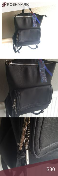 NWT Violet Ray Bag! Selling a Amazing NWT Violet Ray Bag! This bag is genuine leather, has a beautiful design and is stylish inside and out! Effortless New York Fashion, Providing a unique way to express your individuality and style, Simply through the bag on your arm. Violet Ray Bags