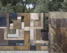 clôture-de-jardin-pierre-naturelle-métal-effet-rouille
