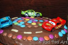 cars party cake, simple, but cute. Also race the cars game with balloons.
