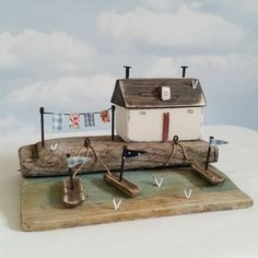 Crofters cottage, base is stormed damaged beach huts, that's been washed up…