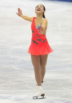 OSAKA, JAPAN - FEBRUARY 09: Mao Asada of Japan competes in the Women's Short Program during day two of the ISU Four Continents Figure Skating Championships at Osaka Municipal Central Gymnasium on February 9, 2013 in Osaka, Japan.