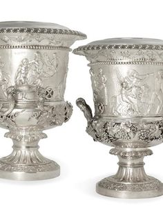 A pair of George IV sterling silver wine coolers by John Edward Terrey, London, 1827 Each fitted with collar and liner, finely chased with wide borders of Neoclassical figures, cast and applied with fruiting grapevine handles and borders, and with gadrooned rims, total weight approximately 280oz troy