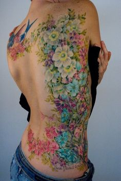 The most amazing Colorful garden of flowers tattoo on back