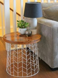 A small wire laundry basket and a circle of plywood come together to make this gorgeous side table. Bonus? It only cost $12 to make. Check out the full tutorial here.