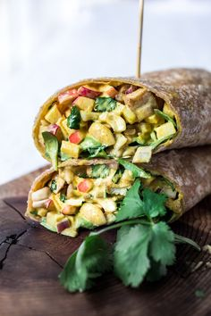 Vegan Curry Tofu Salad Wrap- Turn it into a hearty wrap, stuff into an avocado or served over a bowl of baby spinach. Flavorful and healthy! | www.feastingathome.com #currytofu