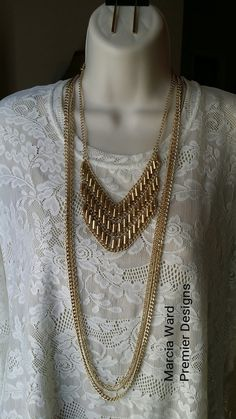 Feel golden in this ensemble: Stiletto earrings, Day To Day necklace framed by the gold strands from Belize.