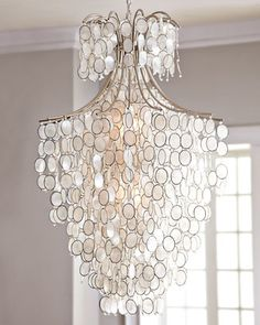 """""""Dripping Capiz"""" Chandelier   by Robles Heritage   at Neiman Marcus.  Robles Heritage  """"Dripping Capiz"""" Chandelier  Price:  $1225.00  Delivery & Processing Only:  150.00  Ceiling canopy included.  Professional installation required.  29""""Dia. x 46""""T with 37.5""""L chain."""