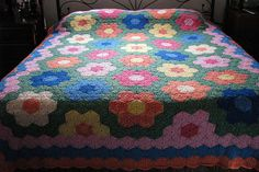 Grandmother's Flower Garden quilt-look crochet blanket from Ravelry....I think this is the most beautiful blanket in the world.