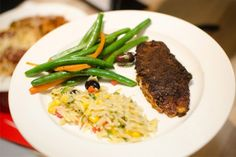 Blackened Tilapia with Herb Vegetable Orzo Salad, Green Beans and Carrots at UMass Amherst