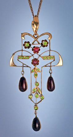 An Art Nouveau Vintage Russian Demantoid and Hessonite Garnet Pendant. Made in Moscow between 1908 and 1917.