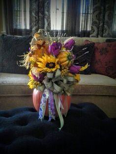 Scarecrow pumpkin fall arrangement