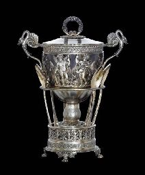 A FRENCH SILVER-GILT COVERED SUGAR BOWL MARK OF ALEXANDRE THIERRY, PARIS, 1819-1838 Vase form, the pedestal base with pierced gallery of putti and festoons, raised on four paw feet, the acanthus decorated stem supporting a pierced bowl of bacchic putti and trophies, with detachable glass liner, the handles formed as swans, the cover with beaded border and berry-clad ring handle