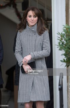Duchess of Cambridge, wearing a 'Rubik' coat by Reiss, attends an official visit to the Action on Addiction Centre for addiction treatment studies on December 10, 2015 in Warminster, England.