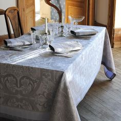 A silver or grey tablecloth is always appropriate for a holiday meal.