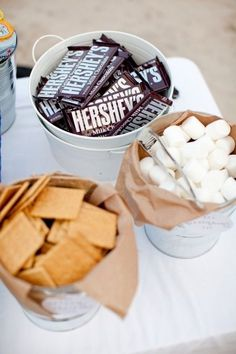 s'mores on the beach The best summertime dessert deserves its own party. Display the ingredients in cute buckets, set up a bonfire at the beach, and get toasting.