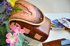 A personal favorite from my Etsy shop https://www.etsy.com/listing/231324735/grapevine-belt-bag-made-of-hand-tooled