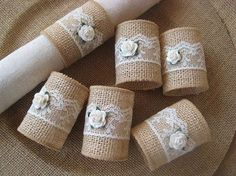 Burlap napkin rings will add a touch of rustic charm to your table top. Burlap rings are wrapped with ivory lace and accented with a miniature rose in a creamy, white color. Just slip them on your napkins for a bit of rustic elegance. Each measures 2.5  long, 1.5 in diameter.  ****This listing is for 6 napkin rings..****