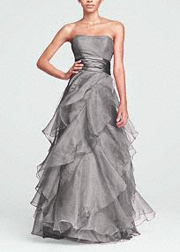 The perfect complement to a glamorous bride, this enchanting organza ball gown has it all!  Strapless empire bodice features ruched waist that flatters any figure.  Tiered organza A- Line skirt is utterly romantic.  Ball gown silhouette is dramatic and slimming.  Fully lined. Back zip. Dry clean only.