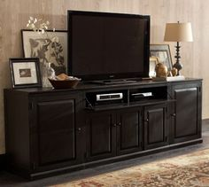 Need something like this for the giant tv. Love how the accessories help it blend in some.