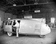 Buckminster Fuller and his three-wheeled Dymaxion car, 1945.