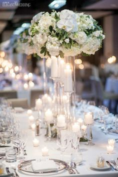 White Wedding Centrepieces, Luxury Wedding Table | Luxurious Wedding with White & Green Florals
