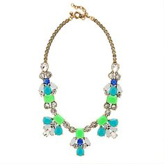 J Crew Bright stone necklace  Crafted with a mix of neon-colored stones that almost glow (think luminescent green and turquoise) and clear faceted crystals, this summery necklace has an easy, airy vibe we love.