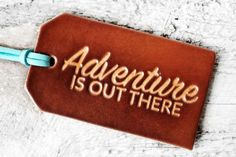 A classic adventure quote from the Disney Pixar movie UP! Adventure IS out there! This quote makes a great graduation gift as well as wedding gifts, leather luggage tag wedding favors, third anniversa