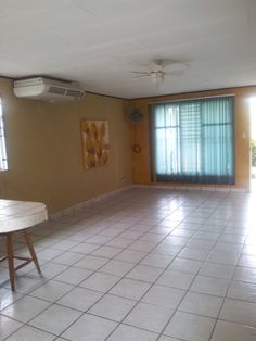 The front part of living room, dining room, Inside the beach house at Jaco for rent or for our Fratenity meetings, all like minded, busy people willing to pay a membership for getting mentor's help to make more money with our extra time
