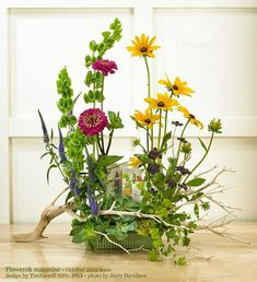 """The effect of a """"wildflower"""" garden is created with the choice of materials and by their placement in naturalistic groupings. Packets of wildflower seeds inside the arrangement add the final touch"""