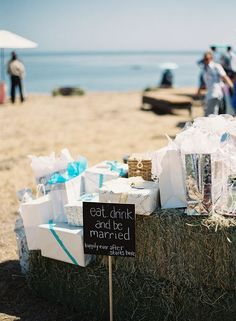 Cute DIY gift table sign on hay bales. Eat, Drink and Be Married in Santa Barbara, CA. http://www.cateringconnect.com Photography by Patrick Moyer