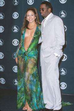 One of the most unforgettable Grammy's outfits would have to be  JLo  in 2001 with this number!  Everyone was sitting on the edge of their seats waiting for the moment that she would accidentally expose more than she bargained for, but it never happened, thanks to some special glue that kept the dress in place!