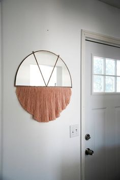 Since fringe is officially back and, apparently, here for the long haul, we thought we'd take a look at some of the more recent ideations of the design trend. Fringe adds an element of dimension that makes it a great decorating piece no matter where you place it. Take a look at some of our favorite picks below—ranging from tapestries to seating to everything in between—and try not to spend all of your money in one place!