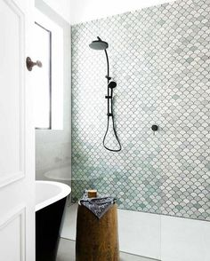 There's something about scallop shell shower tile that always makes me think of the sea and immediately smell a beach breeze and this shower design by Petrina Turner does not disappoint. I love the dark grout and hardware choice - it really makes the shapes pop. I definitely would be a happy girl to wake up to this every day. Bathroom shower tile inspiration via www.L-2-Design.com