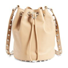 Alpha leather bucket bag by Alexander Wang. A swath of rosegold studs underscores the modern sophistication of an iconic calfskin leather bucket bag that's the e...
