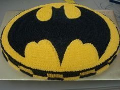 Batman cake - This is a very simple oval sheet cake with BC. The outline of Batman was drawn by hand. This was a request from a customer and I was limited as to how much liberty I was allowed to take. They wanted a simple sheet cake...and thats what they got. Let me know what you think :o)