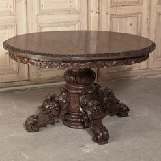 This stunning Antique Renaissance center table was carved from solid walnut in the second part of 19th century in the northern France. It is a rare specimen to find in walnut as most tables of this style where fabricated in oak. Notice the special carved banding on the edge of the top and the condition as of an antique passed among the generations that were well loved. Supported by grand and stately, expertly hand carved della robia themed pedestal. It's the perfect table for almost any spot…