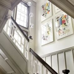 Black banister and finials, white newels and balusters.  eclectic staircase by LDa Architecture & Interiors