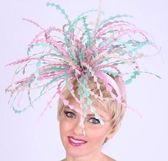 A fantasy of hand sculpted feathers in this Pastel Feather Fascinator by HAT-A-TUDE.com You will be in all the pictures at the Kentucky Derby or Oaks!